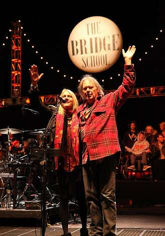 Pegi Young and Neil Young say good night at the Bridge School Benefit Concert at the Shoreline Amphitheatre on Saturday, Oct. 20, 2012, in Mountain View, Calif. (Photo by Barry Brecheisen/Invision/AP) Photo: Barry Brecheisen, Associated Press
