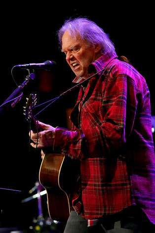 Neil Young performs with Crazy Horse at the Bridge School Benefit Concert at the Shoreline Amphitheatre on Saturday, Oct. 20, 2012, in Mountain View, Calif. (Photo by Barry Brecheisen/Invision/AP) Photo: Barry Brecheisen, Associated Press
