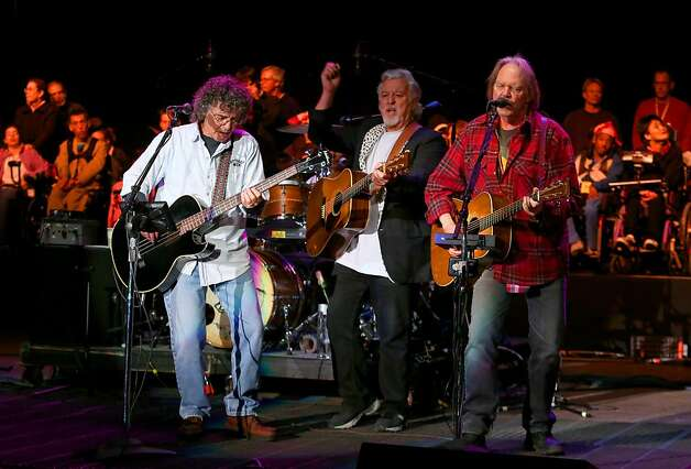 Crazy Horse's Billy Talbot,  Frank Sampedro and Neil Young perform at the Bridge School Benefit Concert at the Shoreline Amphitheatre on Saturday, Oct. 20, 2012, in Mountain View, Calif. (Photo by Barry Brecheisen/Invision/AP) Photo: Barry Brecheisen, Associated Press