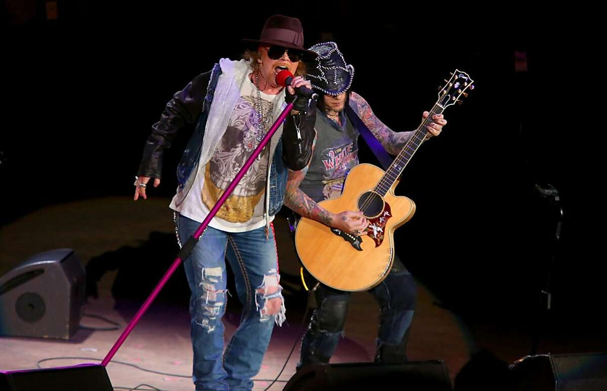 Axl Rose and DJ Ashba of Guns N' Roses perform at the Bridge School Benefit Concert at the Shoreline Amphitheatre on Saturday, Oct. 20, 2012, in Mountain View, Calif. (Photo by Barry Brecheisen/Invision/AP)