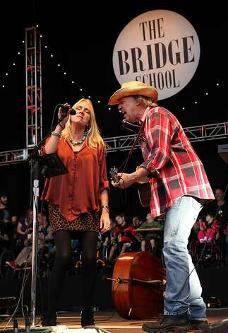 Peggy Young and Neil Young perform at the Bridge School Benefit Concert at the Shoreline Amphitheatre on Saturday, Oct. 20, 2012, in Mountain View, Calif. (Photo by Barry Brecheisen/Invision/AP) Photo: Barry Brecheisen, Associated Press