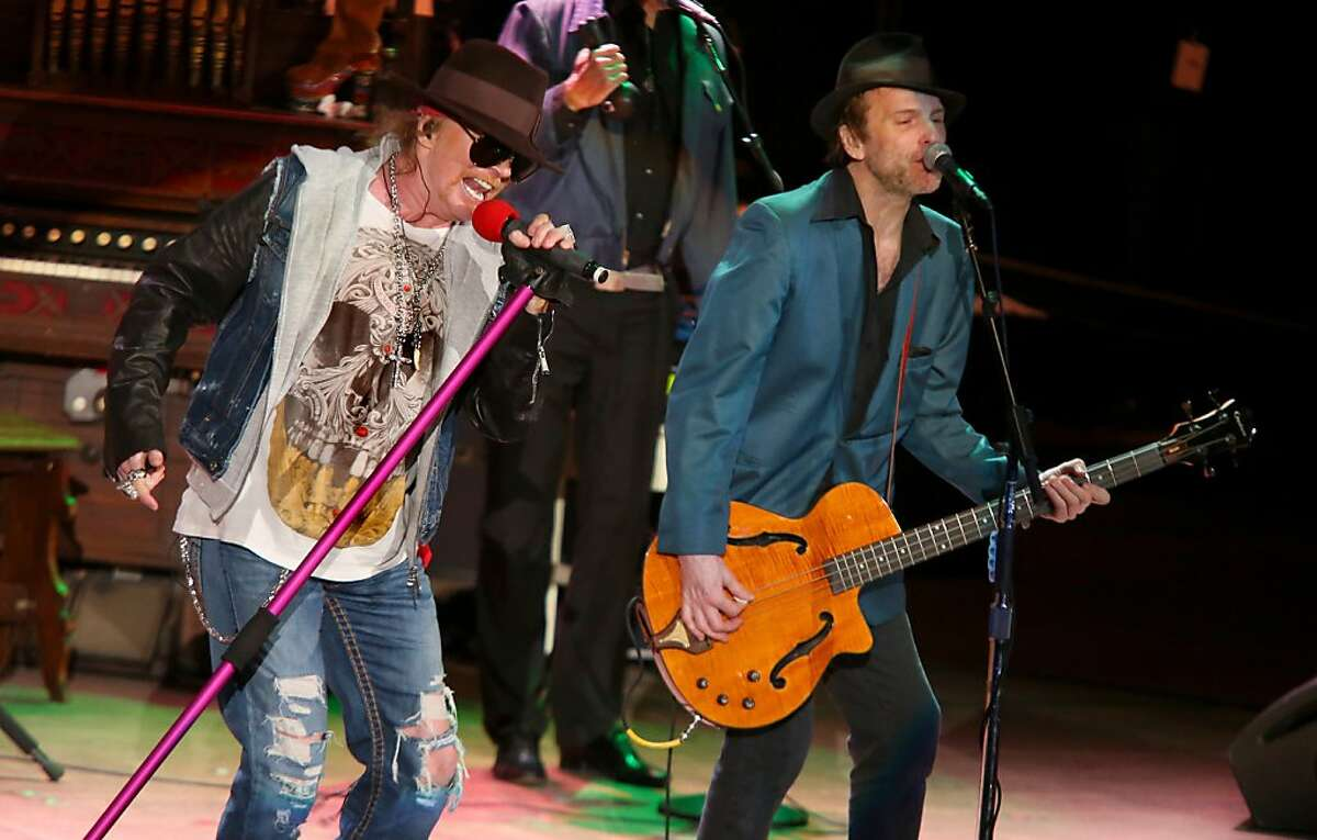 Axl Rose and Tommy Stinson of Guns N' Roses perform at the Bridge School Benefit Concert at the Shoreline Amphitheatre on Saturday, Oct. 20, 2012, in Mountain View, Calif. (Photo by Barry Brecheisen/Invision/AP)