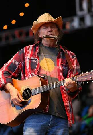Neil Young performs at the Bridge School Benefit Concert at the Shoreline Amphitheatre on Saturday, Oct. 20, 2012, in Mountain View, Calif. (Photo by Barry Brecheisen/Invision/AP) Photo: Barry Brecheisen, Associated Press