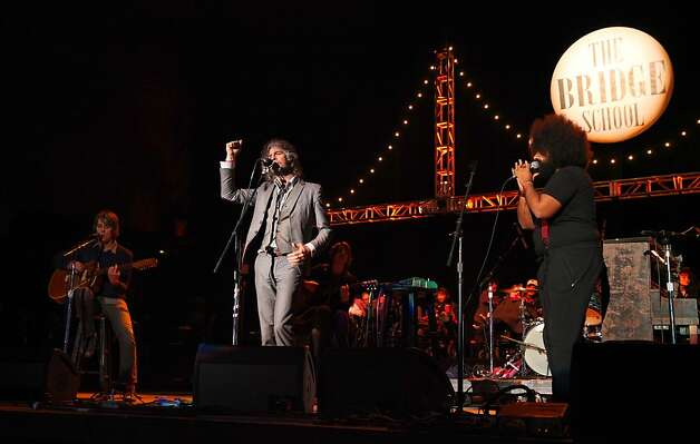 Derek Brown and Wayne Coyne of The Flaming Lips performs with comedian Reggie Watts at the Bridge School Benefit Concert at the Shoreline Amphitheatre on Saturday, Oct. 20, 2012, in Mountain View, Calif. (Photo by Barry Brecheisen/Invision/AP) Photo: Barry Brecheisen, Associated Press