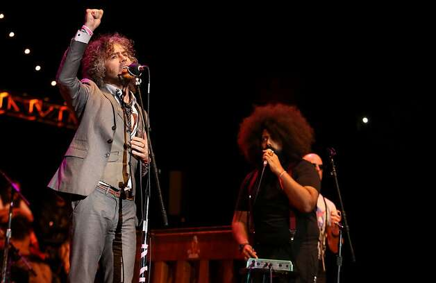 Wayne Coyne of The Flaming Lips performs with comedian Reggie Watts at the Bridge School Benefit Concert at the Shoreline Amphitheatre on Saturday, Oct. 20, 2012, in Mountain View, Calif. (Photo by Barry Brecheisen/Invision/AP) Photo: Barry Brecheisen, Associated Press
