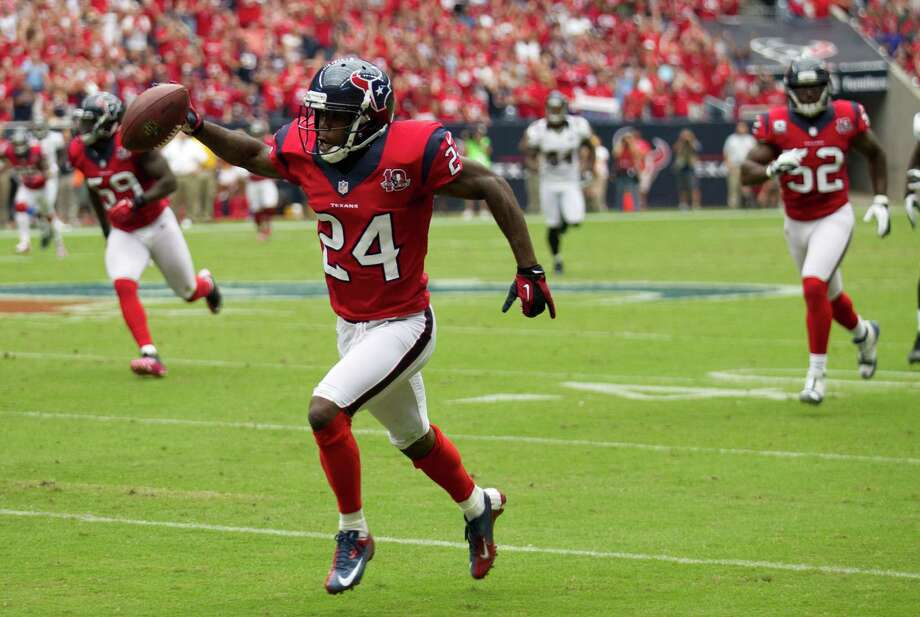 Houston Texans cornerback Johnathan Joseph (24) heads to the end zone during the second quarter at Reliant Stadium on Sunday, Oct. 21, 2012, in Houston. Photo: Brett Coomer, Houston Chronicle / © 2012  Houston Chronicle