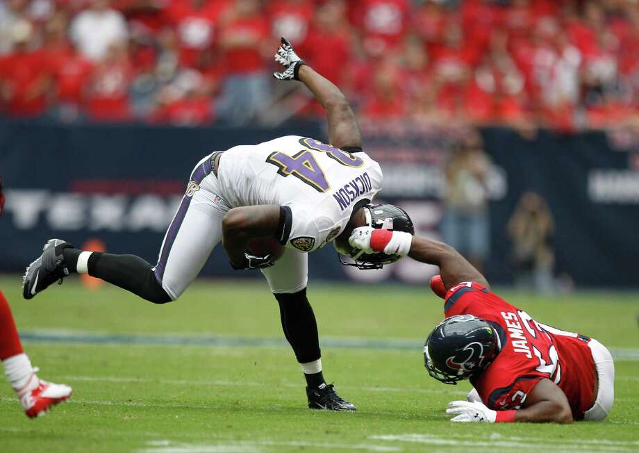 Houston Texans inside linebacker Bradie James (53) tries to bring down Baltimore Ravens tight end Ed Dickson (84) by his helmet during the first quarter at Reliant Stadium on Sunday, Oct. 21, 2012, in Houston. Photo: Brett Coomer, Houston Chronicle / © 2012  Houston Chronicle