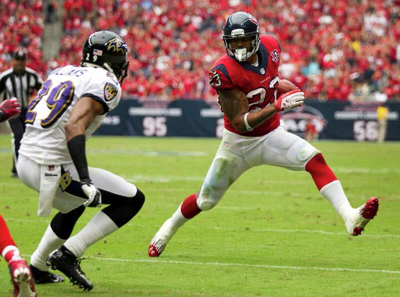 Houston Texans running back Arian Foster (23) rounds the corner against Baltimore Ravens cornerback