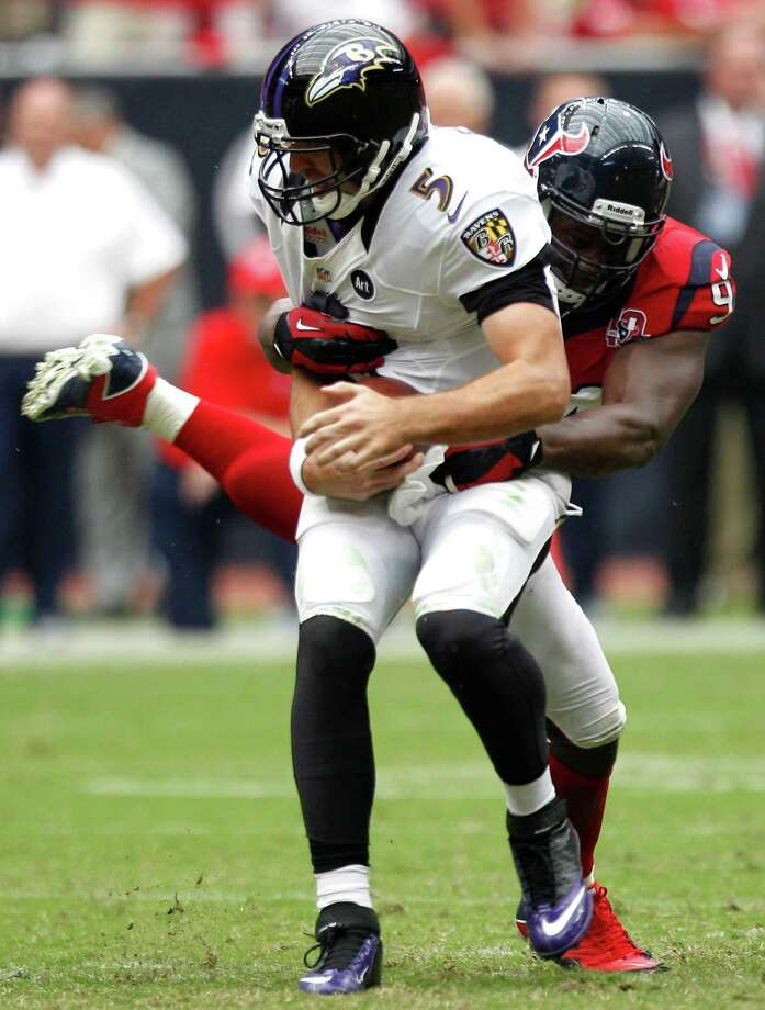 Baltimore Ravens quarterback Joe Flacco (5) is sacked by Houston Texans defensive end Antonio Smith (94) during the fourth quarter at Reliant Stadium on Sunday, Oct. 21, 2012, in Houston. The Texans beat the Ravens 43-13. Photo: Brett Coomer, Houston Chronicle / © 2012  Houston Chronicle