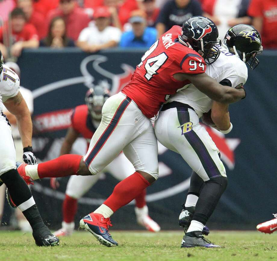 Houston Texans defensive end Antonio Smith (94) sacks Baltimore Ravens quarterback Joe Flacco (5) during the fourth quarter of an NFL football game at Reliant Stadium, Sunday, Oct. 21, 2012, in Houston. Texans won 43-13. Photo: Karen Warren, Houston Chronicle / © 2012  Houston Chronicle