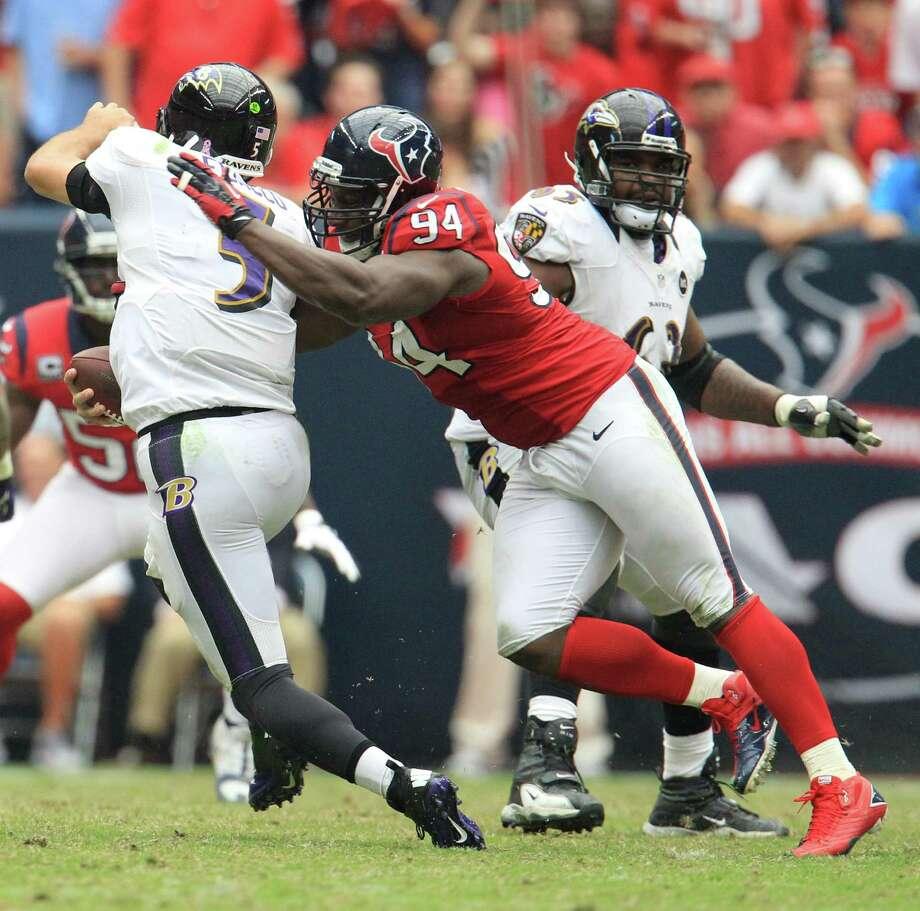Houston Texans defensive end Antonio Smith (94) sacks Baltimore Ravens quarterback Joe Flacco (5) during the fourth quarter of an NFL football game at Reliant Stadium, Sunday, Oct. 21, 2012, in Houston. Texans won 43-13. Photo: Karen Warren, Houston Chronicle / © 2012  Houston Chronicle
