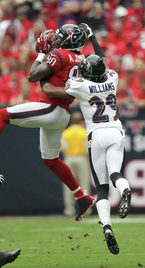 Houston Texans wide receiver Andre Johnson (80) catches the ball over Baltimore Ravens cornerback Cary Williams (29) during the first quarter of an NFL football game, Sunday, Oct. 21, 2012, at Reliant Stadium in Houston. Photo: Nick De La Torre, Houston Chronicle / © 2012  Houston Chronicle