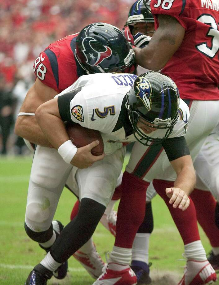 Baltimore Ravens quarterback Joe Flacco (5) is sacked for a safety by Houston Texans outside linebacker Connor Barwin (98) during the first quarter of an NFL football game, Sunday, Oct. 21, 2012, at Reliant Stadium in Houston. Photo: Nick De La Torre, Houston Chronicle / © 2012  Houston Chronicle