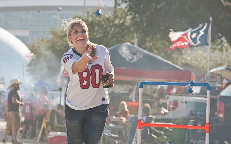 Lindsey Tolopka, of Houston, tailgates with friends before the Houston Texans game against the Balti
