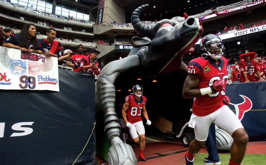 Houston Texans wide receivers Andre Johnson (80) and Kevin Walter (83) run onto the field for warm-ups before the Texans game against the Baltimore Ravens at Reliant Stadium on Sunday, Oct. 21, 2012, in Houston. Photo: Brett Coomer, Houston Chronicle / © 2012  Houston Chronicle
