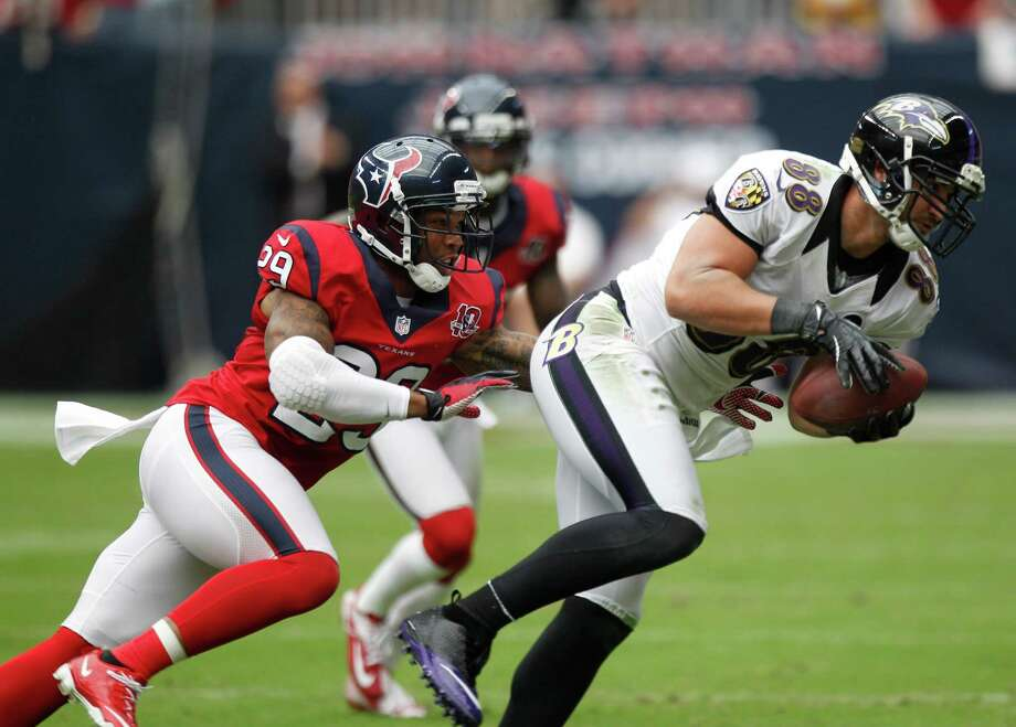 Houston Texans strong safety Glover Quin (29) covers Baltimore Ravens tight end Dennis Pitta (88) during the second quarter at Reliant Stadium on Sunday, Oct. 21, 2012, in Houston. Photo: Brett Coomer, Houston Chronicle / © 2012  Houston Chronicle
