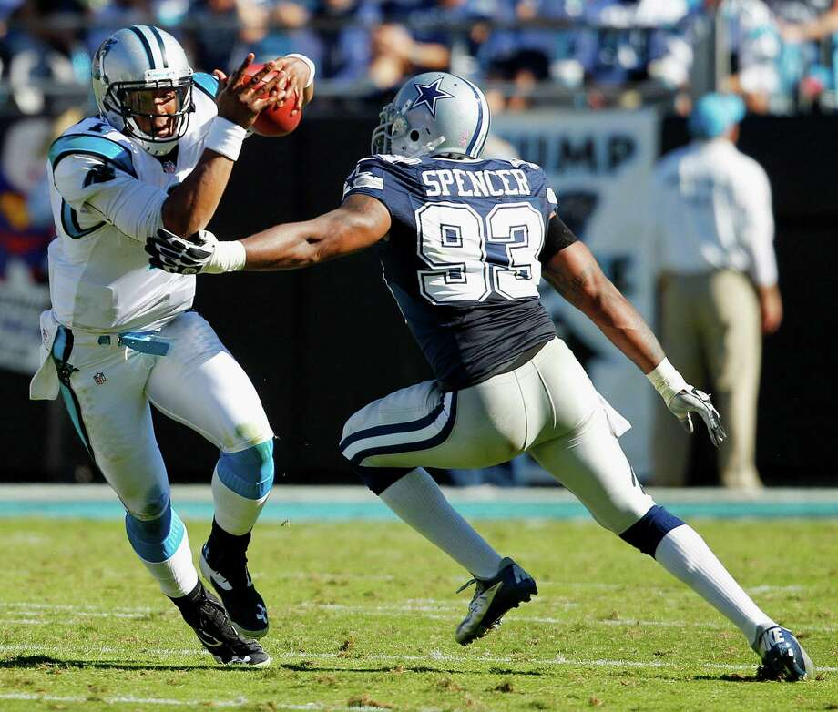 Carolina Panthers quarterback Cam Newton (1) runs from Dallas Cowboys outside linebacker Anthony Spencer (93) during the second half of an NFL football game, Sunday, Oct. 21, 2012, in Charlotte, N.C. (AP Photo/Chuck Burton) Photo: Chuck Burton, Associated Press / AP