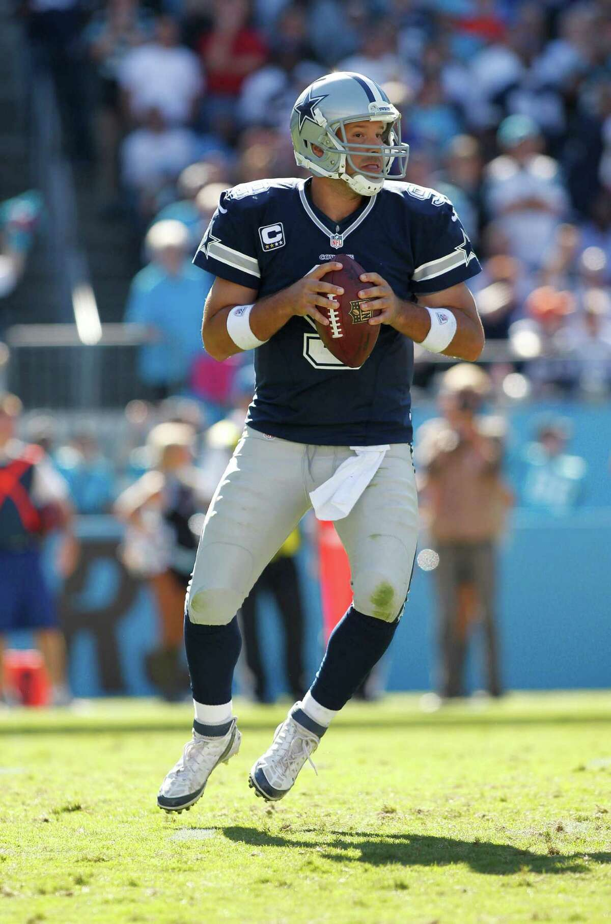 Dallas Cowboys quarterback Tony Romo (9) works against the Carolina Panthers during the second half of an NFL football game, Sunday, Oct. 21, 2012, in Charlotte, N.C. (AP Photo/Bob Leverone)