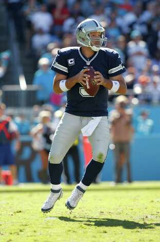Dallas Cowboys quarterback Tony Romo (9) works against the Carolina Panthers during the second half of an NFL football game, Sunday, Oct. 21, 2012, in Charlotte, N.C. (AP Photo/Bob Leverone) Photo: Bob Leverone, Associated Press / FR170480 AP