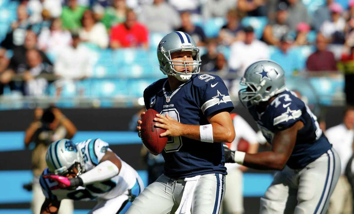 Dallas Cowboys quarterback Tony Romo (9) works against the Carolina Panthers during the second half of an NFL football game, Sunday, Oct. 21, 2012, in Charlotte, N.C. (AP Photo/Chuck Burton)