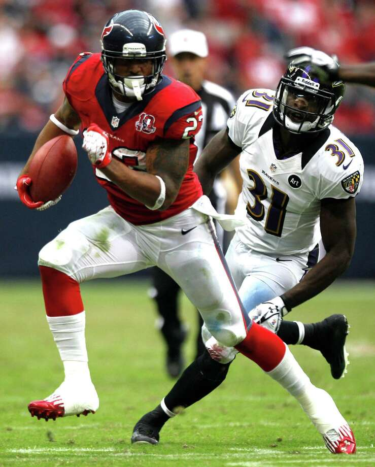 Houston Texans running back Arian Foster (23) runs past Baltimore Ravens strong safety Bernard Pollard (31) during the fourth quarter at Reliant Stadium on Sunday, Oct. 21, 2012, in Houston. The Texans beat the Ravens 43-13. Photo: Brett Coomer, Houston Chronicle / © 2012  Houston Chronicle