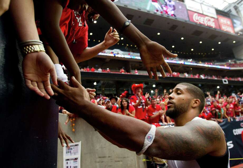 Houston Texans running back Arian Foster high fives fans as he leaves the field after the Texans beat the Baltimore Ravens at Reliant Stadium on Sunday, Oct. 21, 2012, in Houston. The Texans beat the Ravens 43-13. Photo: Brett Coomer, Houston Chronicle / © 2012  Houston Chronicle