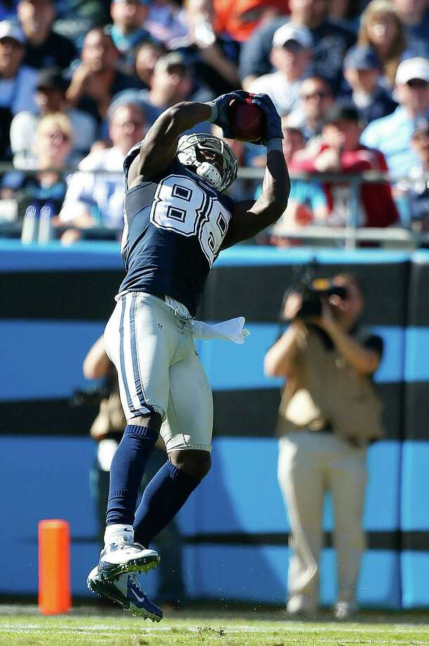 Dallas Cowboys wide receiver Dez Bryant (88) makes a catch downfield against the Carolina Panthers during the second half of an NFL football game, Sunday, Oct. 21, 2012, in Charlotte, N.C. (AP Photo/Bob Leverone) Photo: Bob Leverone, Associated Press / FR170480 AP