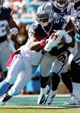 Dallas Cowboys cornerback Morris Claiborne (24) picks off a pass from Carolina Panthers quarterback Cam Newton a Panthers wide receiver Steve Smith , front left, makes the tackle during the first half of an NFL football game on Sunday, Oct. 21, 2012, in Charlotte, N.C. (AP Photo/Bob Leverone) Photo: Bob Leverone, Associated Press / FR170480 AP