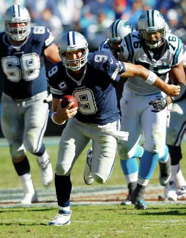 Dallas Cowboys quarterback Tony Romo (9) runs out of the pocket against the Carolina Panthers during the second half of an NFL football game on Sunday, Oct. 21, 2012, in Charlotte, N.C. (AP Photo/Chuck Burton) Photo: Chuck Burton, Associated Press / AP