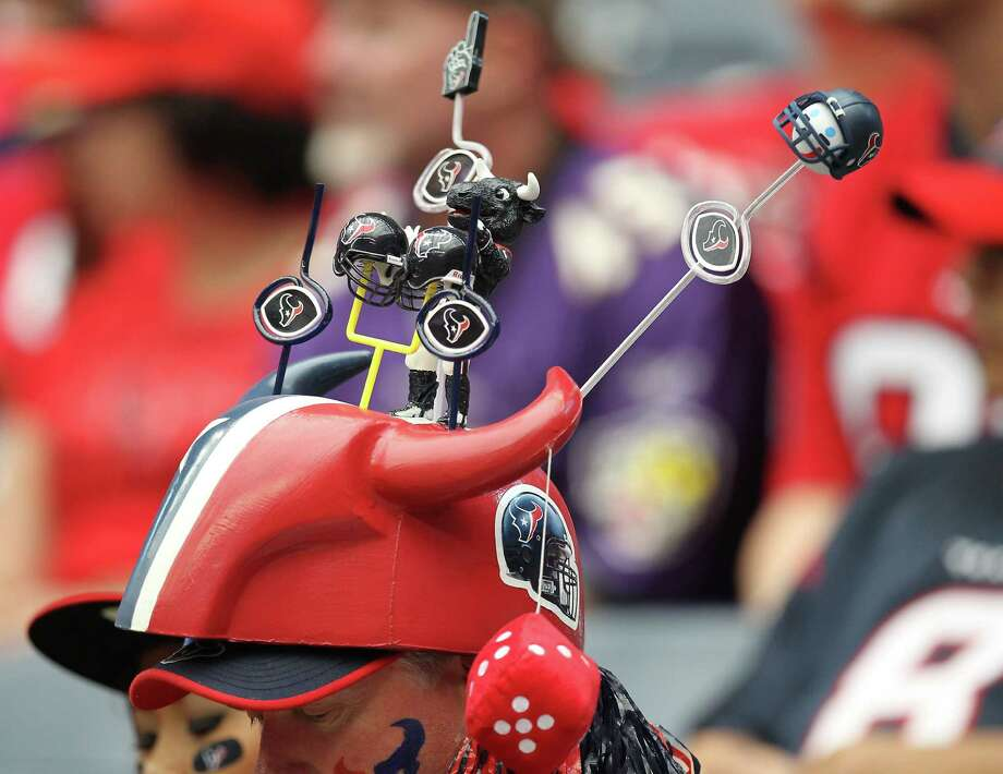 A Texans fan's hat during the first quarter of an NFL football game, Sunday, Oct. 21, 2012, at Reliant Stadium in Houston. Photo: Nick De La Torre, Houston Chronicle / © 2012  Houston Chronicle
