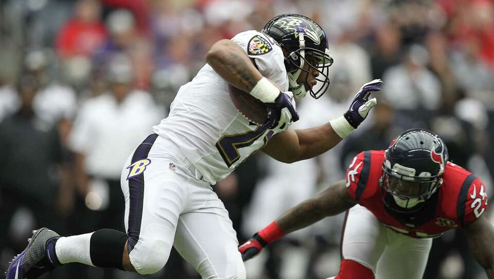 Baltimore Ravens running back Ray Rice (27) tries to avoid the tackle of Houston Texans cornerback K