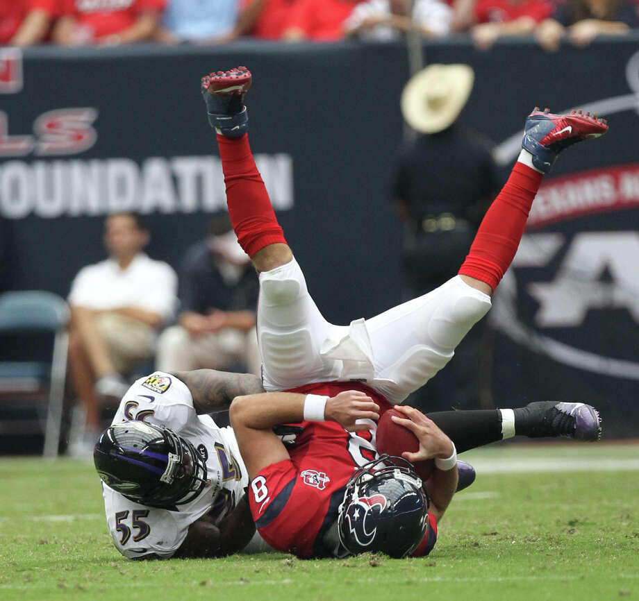 Houston Texans quarterback Matt Schaub (8) is sacked by Baltimore Ravens linebacker Terrell Suggs (55) during the first quarter of an NFL football game, Sunday, Oct. 21, 2012, at Reliant Stadium in Houston. Photo: Nick De La Torre, Houston Chronicle / © 2012  Houston Chronicle