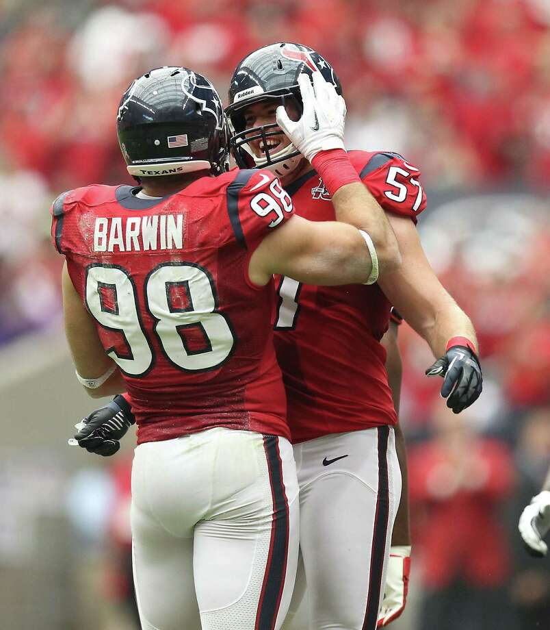 Houston Texans outside linebacker Connor Barwin (98) celebrates his safety sack of Baltimore Ravens quarterback Joe Flacco (5) with Houston Texans linebacker Jesse Nading (57) during the first quarter of an NFL football game, Sunday, Oct. 21, 2012, at Reliant Stadium in Houston. Photo: Nick De La Torre, Houston Chronicle / © 2012  Houston Chronicle