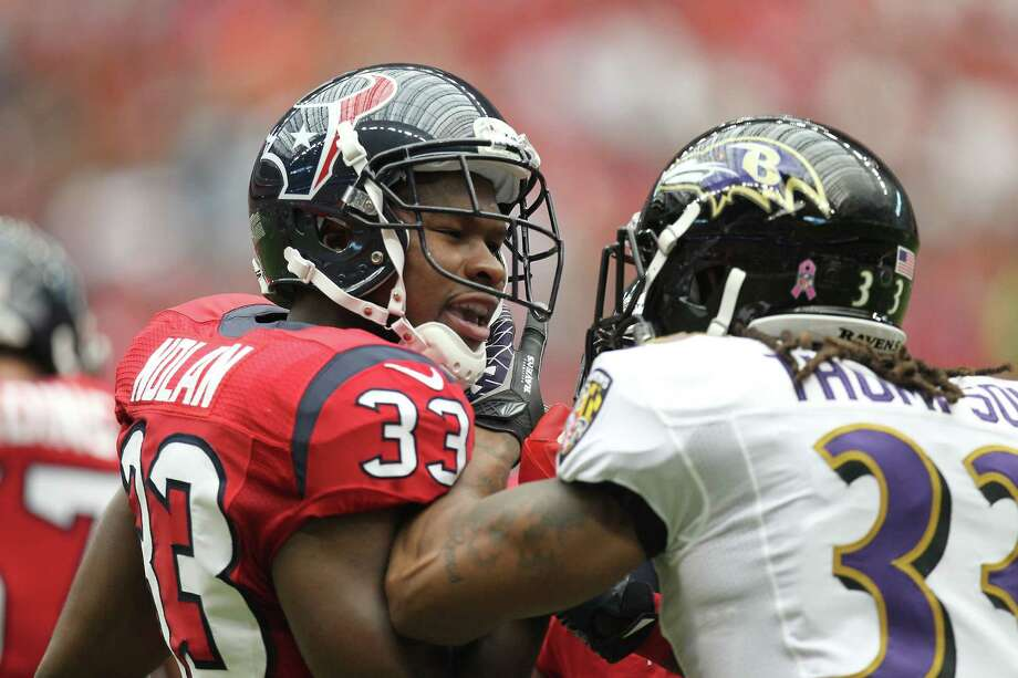Baltimore Ravens free safety Christian Thompson (33) jaws with Houston Texans defensive back Troy Nolan (33) during the second quarter of an NFL football game, Sunday, Oct. 21, 2012, at Reliant Stadium in Houston. Photo: Nick De La Torre, Houston Chronicle / © 2012  Houston Chronicle