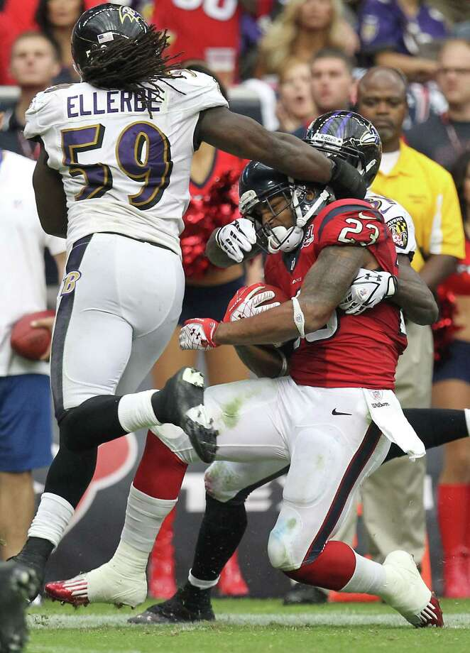 Baltimore Ravens linebacker Dannell Ellerbe (59) swats Houston Texans running back Arian Foster (23) on the head during the fourth quarter of an NFL football game, Sunday, Oct. 21, 2012, at Reliant Stadium in Houston. Photo: Nick De La Torre, Houston Chronicle / © 2012  Houston Chronicle