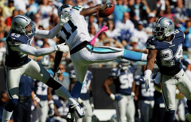 Carolina Panthers wide receiver Brandon LaFell (11)  can't make the reception while being defended by Dallas Cowboys free safety Gerald Sensabaugh (43) and cornerback Morris Claiborne (24)  during the second half of an NFL football game, Sunday, Oct. 21, 2012, in Charlotte, N.C. (AP Photo/Chuck Burton) Photo: Chuck Burton, Associated Press / AP