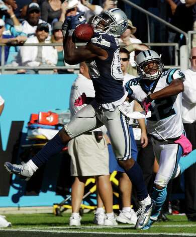 Dallas Cowboys wide receiver Dez Bryant (88) bobbles a touchdown pass as Carolina Panthers defensive back Josh Thomas (22) defends during the second half of an NFL football game, Sunday, Oct. 21, 2012, in Charlotte, N.C. There was no touchdown on the play. (AP Photo/Chuck Burton) Photo: Chuck Burton, Associated Press / AP