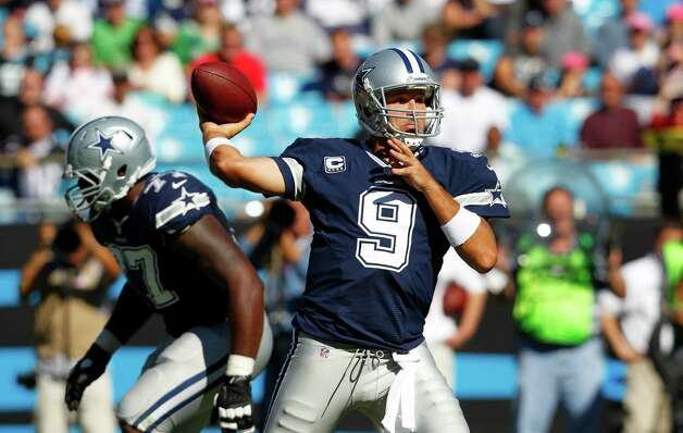 Dallas Cowboys quarterback Tony Romo (9) works against the Carolina Panthers during the second half of an NFL football game, Sunday, Oct. 21, 2012, in Charlotte, N.C. (AP Photo/Chuck Burton) Photo: Chuck Burton, Associated Press / AP