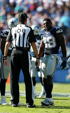 Dallas Cowboys wide receiver Dez Bryant (88) speaks with Line Judge Gary Arthur during the second half of an NFL football game against the Carolina Panthers, Sunday, Oct. 21, 2012, in Charlotte, N.C. (AP Photo/Bob Leverone) Photo: Bob Leverone, Associated Press / FR170480 AP