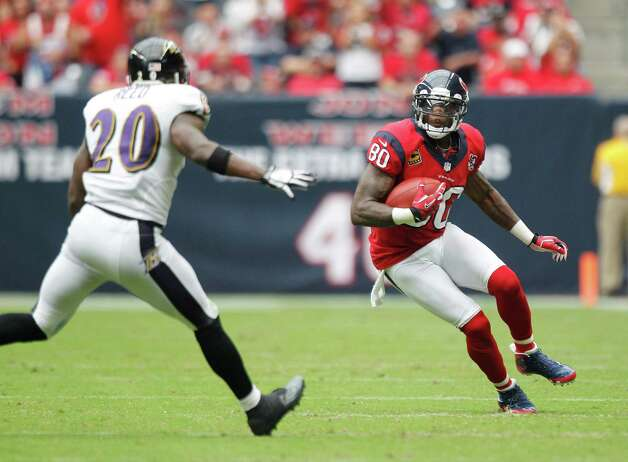 Houston Texans wide receiver Andre Johnson (80) runs the ball against Baltimore Ravens free safety Ed Reed (20) during the second quarter at Reliant Stadium on Sunday, Oct. 21, 2012, in Houston. Photo: Brett Coomer, Houston Chronicle / © 2012  Houston Chronicle