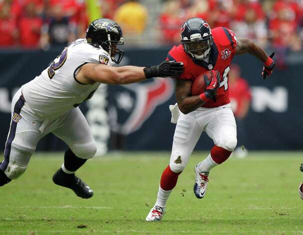 Houston Texans running back Ben Tate (44) runs up the field as he is grabbed by Baltimore Ravens defensive end Haloti Ngata (92) during the second quarter at Reliant Stadium on Sunday, Oct. 21, 2012, in Houston. Photo: Brett Coomer, Houston Chronicle / © 2012  Houston Chronicle