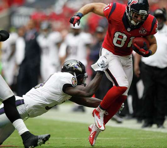 Houston Texans tight end Owen Daniels (81) tries to avoid the tackle from Baltimore Ravens strong safety Bernard Pollard (31) during the second quarter at Reliant Stadium on Sunday, Oct. 21, 2012, in Houston. Photo: Brett Coomer, Houston Chronicle / © 2012  Houston Chronicle