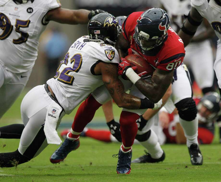 Houston Texans wide receiver Andre Johnson (80) is tackled by Baltimore Ravens defensive back Jimmy Smith (22) during the first quarter at Reliant Stadium on Sunday, Oct. 21, 2012, in Houston. Photo: Brett Coomer, Houston Chronicle / © 2012  Houston Chronicle