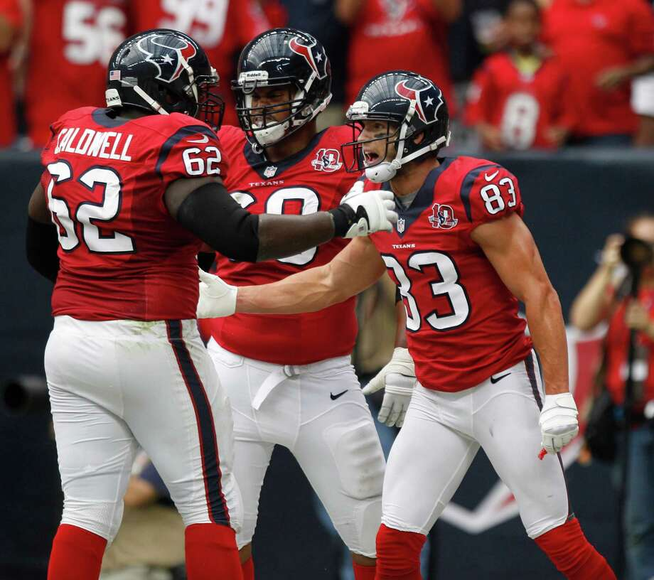 Houston Texans wide receiver Kevin Walter (83) celebrates his touchdown with teammates during the first quarter at Reliant Stadium on Sunday, Oct. 21, 2012, in Houston. Photo: Brett Coomer, Houston Chronicle / © 2012  Houston Chronicle