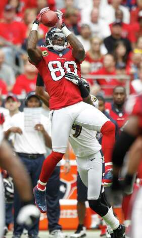 Houston Texans wide receiver Andre Johnson (80) hauls in a pass over Baltimore Ravens cornerback Cary Williams (29) during the first quarter at Reliant Stadium on Sunday, Oct. 21, 2012, in Houston. Photo: Brett Coomer, Houston Chronicle / © 2012  Houston Chronicle