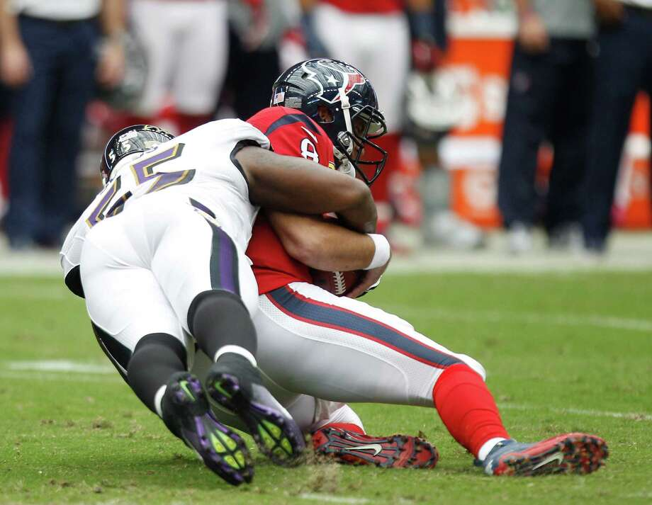 Houston Texans quarterback Matt Schaub (8)gets sacked by Baltimore Ravens linebacker Terrell Suggs (55) during the first quarter at Reliant Stadium on Sunday, Oct. 21, 2012, in Houston. Photo: Brett Coomer, Houston Chronicle / © 2012  Houston Chronicle