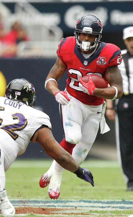 Houston Texans running back Arian Foster (23) tries to avoid the tackle of Baltimore Ravens nose tackle Terrence Cody (62) during the second quarter at Reliant Stadium on Sunday, Oct. 21, 2012, in Houston. Photo: Brett Coomer, Houston Chronicle / © 2012  Houston Chronicle