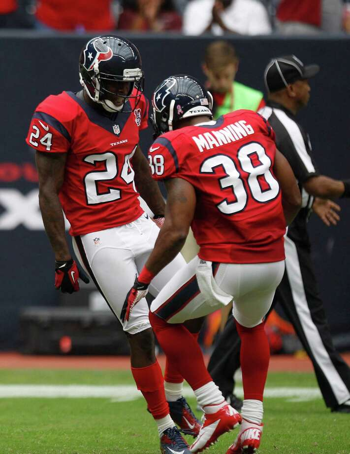 Houston Texans cornerback Johnathan Joseph (24) and Houston Texans free safety Danieal Manning (38) celebrates Joseph's touchdown run during the second quarter at Reliant Stadium on Sunday, Oct. 21, 2012, in Houston. Photo: Brett Coomer, Houston Chronicle / © 2012  Houston Chronicle