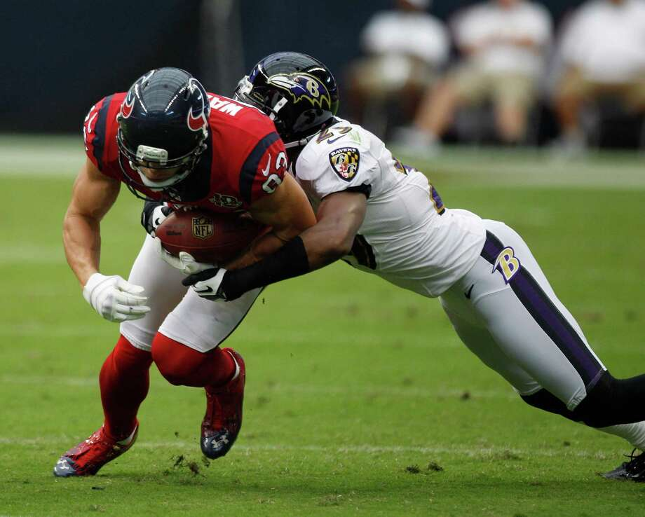 Houston Texans wide receiver Kevin Walter (83) gains yardage against Baltimore Ravens cornerback Cary Williams (29) during the second quarter at Reliant Stadium on Sunday, Oct. 21, 2012, in Houston. Photo: Brett Coomer, Houston Chronicle / © 2012  Houston Chronicle