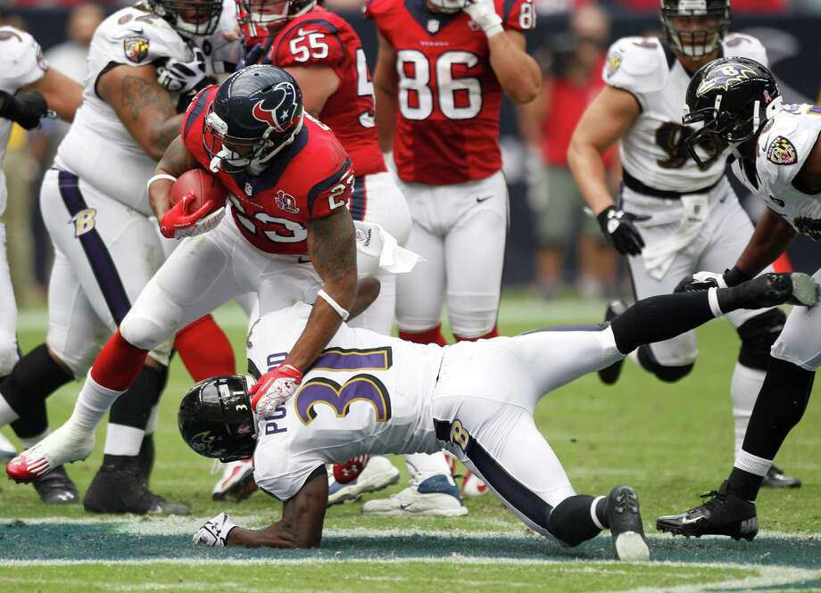 Houston Texans running back Arian Foster (23) runs over Baltimore Ravens strong safety Bernard Pollard (31) during the second quarter at Reliant Stadium on Sunday, Oct. 21, 2012, in Houston. Photo: Brett Coomer, Houston Chronicle / © 2012  Houston Chronicle